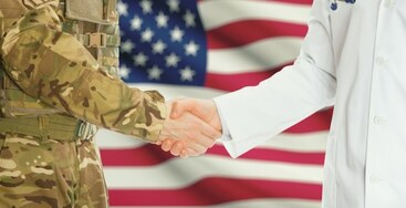 Image of military member and employer shaking hands.
